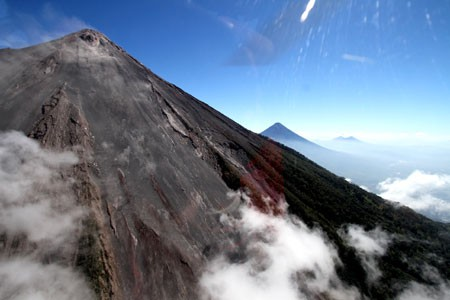 Flying among smoking volcanoes by helicopter